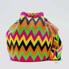 Cabo Wayuu Mochila bags are intricate in their designs, taking approximately 14 days to weave.  The braided strap has its own unique design. Handmade in South A