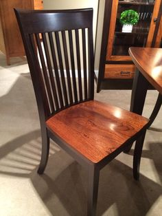 A combination of light and dark wood give this dining chair heightened character.  What do you think of the two-tone wood trend? #hpmkt #hpmkt2014 #shopgf | Houston TX | Gallery Furniture |