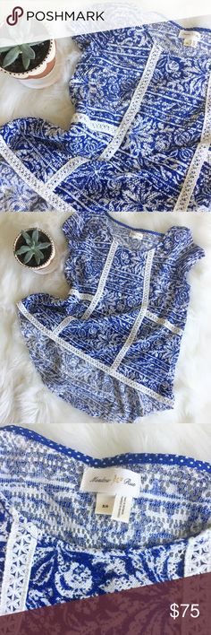 Anthropologie Meadow Rue Crochet Floral Hi-lo Top Gorgeous hi-lo floral print top has crochet ribbon detail throughout and peplum detail in back. Classic blue and white! In excellent condition!!! Rare find! Anthropologie Tops Blouses