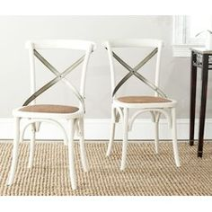 No chair is as famous as Thonet's bent wood café model, and One Allium Way Argyle X back side chair pays homage to the beloved original. Your kitchen or dining room will conjure images of Vienna café society with Argyle bent metal frame in antique white finish, rattan seat and authentic arch brace in black metal.
