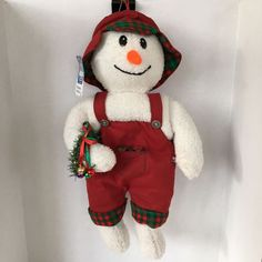 North Pole Snowmen Christmas Stocking Hooked NWT 18 Inches Plush Soft Character The back has a Snap and Go Hook. The greens on the Snowmans arm has bells that jingle. This Snowman is very cute and have a cute personality. The Snowman is wearing cute Corduroy Red Overalls and a Corduroy Red and Green Bucket Hat. | eBay!