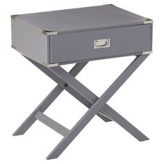 Play up a traditional aesthetic or give a modern space a stylish twist with this eye-catching end table, featuring a crisscross base and briefcase-inspire...