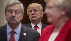 President Donald Trump, flanked by Iowa Gov. Terry Branstad, left, and Alabama Gov. Kay Ivey,  attends a federalism event before signing the Education Federalism Executive Order, Wednesday, April 26, 2017, in the Roosevelt Room of the White House in Washington.  (AP Photo/Andrew Harnik)