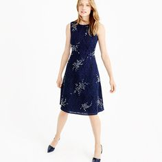 """Crafted from a special bonded mesh lace and finished with hand-applied crystals in a sunburst motif, this is one of those head-turning, compliment-earning dresses that deserves a special place in your closet. <ul><li>A-line silhouette.</li><li>Falls to knee, 40 1/2"""" from high point of shoulder (based off size 6).</li><li>Poly.</li><li>Back zip.</li><li>Lined.</li><li>Dry clean.</li><li>Import.</li></ul>"""