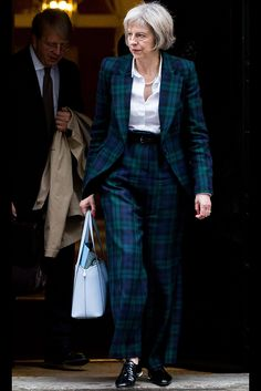 Theresa May paired her Vivienne Westwood tartan blue suit with a pair of Russell & Bromley brogues.
