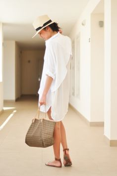 A simple and chic summer look - white shirt dress, tan sandals and a panama hat / the love assembly