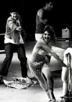 Michael Diamond and Adam Yauch of Beastie Boys chasing Madonna around the stage with squirt guns in Madison Square Garden, 1985.