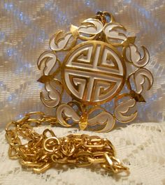 Hey, I found this really awesome Etsy listing at http://www.etsy.com/listing/157545321/vintage-crown-trifari-large-gold-and