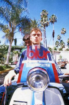 Damon Albarn and Graham Coxon riding a Lambretta.