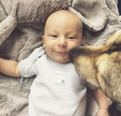 Baby Hudson and his furry friend George are huge fans of our 100% organic cotton bodysuits!