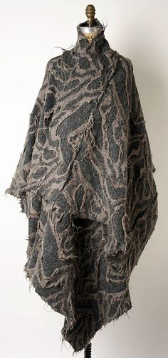 Issey Miyake felted cape. (Japanese, born 1938) Design House: Miyake Design Studio (Japanese) Date: ca. 1983 Culture: Japanese Medium: wool, acrylic, other blend.