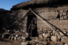 Carmelo Flores Laura, a native Aymara, sits outside his home in the village of Frasquia, Bolivia, Tuesday, Aug. 13, 2013. If Bolivia's public records are correct, Flores is the oldest living person ever documented. They say he turned 123 a month ago. His grandson, Edwin, says he fought in the 1933 Chaco war with Paraguay but he said he only faintly remembers that. (AP Photo/Juan Karita)