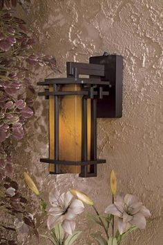 """Lugarno Square 13 3/4"""" High Bronze Outdoor Light by Minka Lavery. $168.00. Minka-Lavery artisans delight us with another elegant fixture from their Lugarno Square collection. It features a Dorian Bronze finish and amber art glass for a resplendent glow. This wall mount fixture comes with one 13 watt fluorescent bulb.. Save 38%!"""