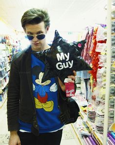 Matt Smith. My Guy wears a Mickey Mouse sweat shirt. That's hot! :D
