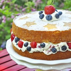 Red White and Blue Mascarpone Cream Butter Cake - celebrate 4th of July with this super simple, rich butter cake with fresh strawberries and blueberries folded in to a luscious mascarpone cream cheese filling.