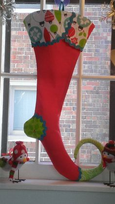 All of my stockings are handmade and very detailed! This is a pre-made stocking and is ready to ship! This stocking is crafted out of 100% cotton. The heel is a bright green holly pattern and the toe is in bright green whimsy tonal!!