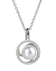 1dfce607f292 Dije en oro blanco de 18 kilates con perla cultivada y diamantes. 18K White  gold pendant with cultivated pearl and diamonds