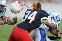 Lebanon's Jose Gonzalez loses his helmet as he tries to tackle Erickson Gonzalez during the first half of the 41st annual Cedar Bowl on August 31, 2012. LEBANON DAILY NEWS - JEREMY LONG