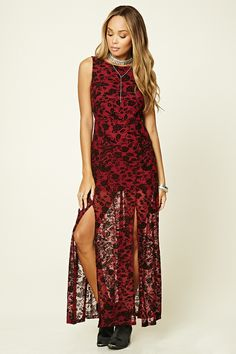 A knit sleeveless maxi dress crafted from semi-sheer mesh with an allover ornate velvet floral design featuring a built-in mini slip, a round neckline, a deep V back with an invisible zipper, and a front M-slit.