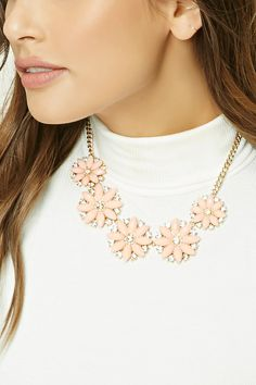 A midweight statement necklace featuring a rhinestone-encrusted flower design with a high-shine finish and a lobster clasp.