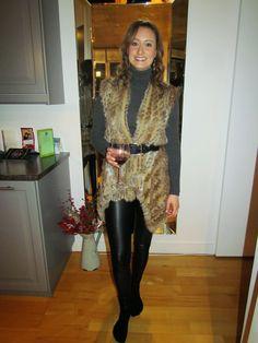 a second glance.: cashmere turtleneck, belted fur vest, faux leather leggings