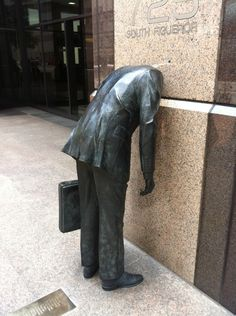 """""""Corporate Head"""" sculpture by Terry Allen (c. 1991) Located at 725 S. Figueroa in downtown  Plaque on ground behind sculpture reads: """"They said I had a head for business. They said to get ahead I had to lose my head. They said be concrete and I became concrete. They said, go, my son, multiply, divide, conquer. I did my best."""""""