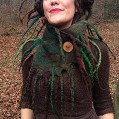 The Dryadic Roots Felted scarf, earthy woodland nomad cowl, lovingly handcrafted with merino wool in forest bed browns, olive and leaf greens Dreadlocks and tendrils have been felted along the top, bottom and sides of this magical elf scarf for a wild look, it closes on the left side with