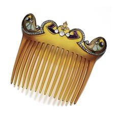 GEM-SET AND DIAMOND HAIR COMB, GEORGE FOUQUET, CIRCA 1900. The foliate scrolled top chased and set with calibré-cut amethyst, buff-top opals and highlighted with circular- and rose-cut diamonds, to a curved blonde tortoiseshell hair comb, signed G.Fouquet, fitted case G.FOUQUET, PARIS. Art Noveau