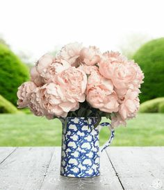 Pale pink peonies in Tory's new Spongeware pitcher, inspired by her favorite 19th-century ceramics.