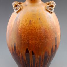 Jen's Juicy Fruit with red iron oxide is on the upper half of this pot. An iron red glaze is on the bottom.