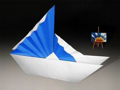 Origami Chinese Ship  This model is the Traditional Chinese Ship with the variant of the chinese sails by Jannie Schuylenburg Folder and Photo: @Origami Kids Difficulty level: Easy Time to fold 10 min. 12 steps. Folded from a one classic Blue and White Single Uncut square origami paper, about 22cm x 22cm. How to fold?   http://origami-blog.origami-kids.com/eng/origami-chinese-ship.htm