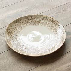 Inspired by Italian sophistication and Balinese artistry, this unique dinnerware collection made of porcelain hand thrown ceramics brings your tabletop a dose of cultural elegance and artistic excelle