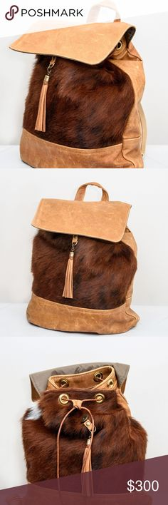 Real Cowhide Fur & Leather Backpack The boss lady backpack comes a great size for everyday use and can easily fit your iPad or laptop. The duffle bag is great for shopping or as a weekend getaway bag; wear it as a cross body to keep your hands free while traveling through the airport or mall. Feature 100% bottom adjustable webbing straps, brass hardware, and inside pockets. Measurements  16″H x 11″W x 4″D Canoe Look Bags Backpacks