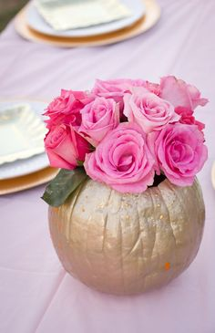 Pink roses in a Golden Pumpkin as centerpieces for a Cinderella birthday in pink and gold. #flowerarrangement