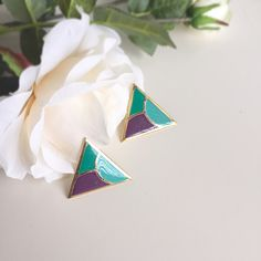 {Vintage Enamel Clip On Earrings} These retro clip on earrings are the perfect gift for any 80's enthusiast! They have some specks of discoloration but it is not noticeable from afar.                                                                      ✅ Offers welcome (use offer button)  ✅ Bundle 2 or more items for 15% off  ❌ Trades ❌ Holds Vintage Jewelry Earrings