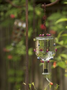 DIY Tequila Bottle Hummingbird Feeder >> http://blog.diynetwork.com/maderemade/2014/09/02/get-ready-for-the-great-hummingbird-migration/?soc=pinterest