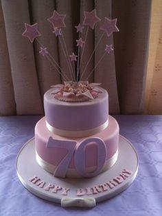 "www.daisycupcakery.com ""Explosion"" Two tier birthday cake"