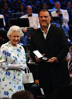 The Queen presents The Queen's Medal for Music to Welsh opera singer Bryn Terfel during a special BBC Proms concert to celebrate Her Majesty...