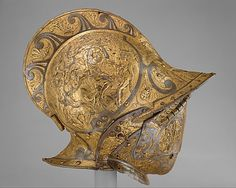 Burgonet with Falling Buffe     Probably made for Henry II of France (reigned 1547–59), the helmet passed as a diplomatic gift to the Medici court in Florence later in the sixteenth century. It is illustrated in a portrait of Cosimo II de' Medici (1590–1621), grand duke of Tuscany, in the Metropolitan Museum's collection (acc. no. 22.150)....see pin of portrait