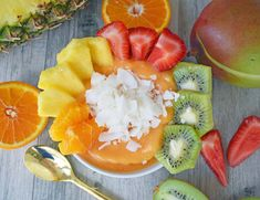 Kissed by Sunshine Dole Smoothie Bowl made with frozen fruit blend, juice or coconut, topped with fresh berries, pineapple, kiwi, oranges, and coconut