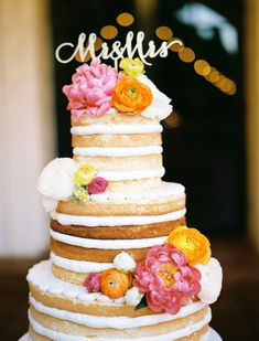 naked wedding cake - photo by Ben Q Photography http://ruffledblog.com/whimsical-garden-wedding-in-dallas #weddingcake #cakes