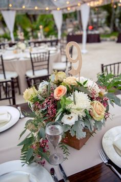 A Romantic Oceanside Wedding In The Keys via TheELD.com | Lucius floral centerpiece | Kristen Edwards Photography