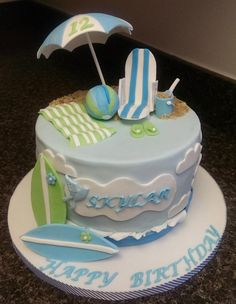 Summer/Beach themed cake - For all your cake decorating supplies, please visit craftcompany.co.uk