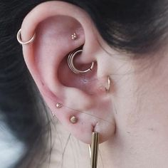 Maria Tash offers her famous clicker design in a classic no stone option. This 14k solid gold ring is perfect for those who want a seamless and simple look in their cartilage, including tragus or ear head (forward helix). The clicking mechanism makes it easy to insert and remove when necessary. The seams of the ring are so smooth we can use these rings for initial piercings. It is a very cute piece, with a very small diameter. A feat of manufacturing. <br><br>Item ...