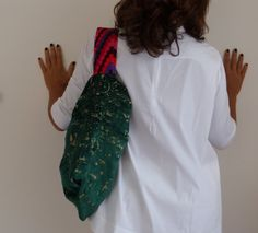 This one-of-a-kind emerald green oversized damask hobo purse bag Shoulder bag, in a simple pentagonal form. It delights with the combining of the most fashionable colours. Made with the highest quality soft Italian upholstery fabric, with a geometric design. Add some Italian style to any outfit with this unique hobo. Colors are emerald green, beige and the strap is chevron orange, violet, dark green, dark green and pink.