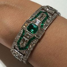 Platinum, emerald and diamond bracelet, 1930s. Sotheby's Magnificent & Noble Jewels, Geneva,