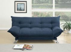 A sporty and luxurious design graces the surface of this super plush pillow-style adjustable sofa that features accent tufting and short silver leg supports. Available in dark fiber, willow, and navy