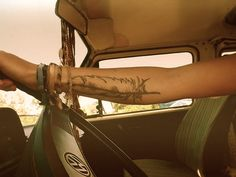 This is such a cute feather tattoo!