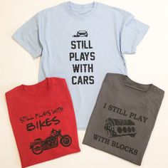 For all the men out there who are still playing with their blocks, bikes, and cars. These fun tees make perfect Father's Day gifts!Available in 3 color options and 3 designs! T Shirt Lyrics, Funny Fathers Day Gifts, Dad Humor, Funny Tees, Cool Tees, Shirts, Project Ideas, Craft Ideas, Cars