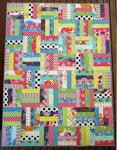 I've actually made one of these, but it had a color scheme. But I LOVE scrap quilts.